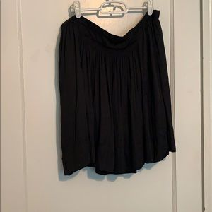 Black pleated silk-like mini skirt
